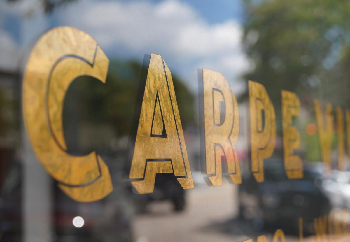 Carpe Vinum 121 on storefront gold